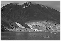 Sunset light falling on the base of the peaks around Tarr Inlet. Glacier Bay National Park, Alaska, USA. (black and white)