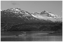 Small boat in Tarr Inlet, early morning. Glacier Bay National Park, Alaska, USA. (black and white)