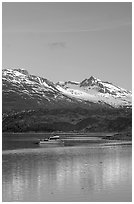 Small boat at the head of Tarr Inlet, early morning. Glacier Bay National Park, Alaska, USA. (black and white)