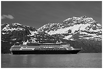 Cruise ship and snowy peaks. Glacier Bay National Park, Alaska, USA. (black and white)