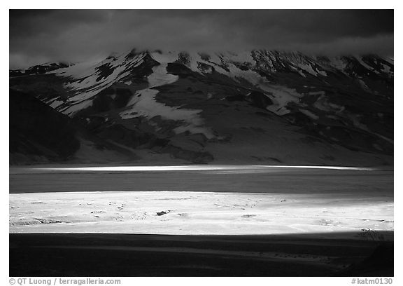 A break in the clouds illuminate the floor of the Valley of Ten Thousand smokes. Katmai National Park (black and white)