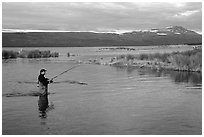 Man fishing for salmon in the Brooks river. Katmai National Park, Alaska, USA. (black and white)