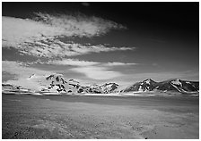 The desert-like floor of the Valley of Ten Thousand smokes is surrounded by snow-covered peaks such as Mt Meigeck. Katmai National Park ( black and white)