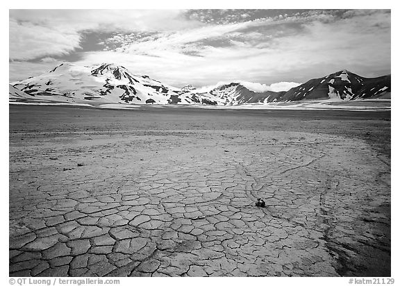 The desert-like floor of the Valley of Ten Thousand smokes is surrounded by snow-covered peaks such as Mt Meigeck. Katmai National Park (black and white)