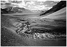 Stream flows from the hills into the floor of the Valley of Ten Thousand smokes. Katmai National Park, Alaska, USA. (black and white)