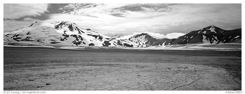 Snow-covered mountains surrounding ash-covered flats. Katmai National Park (black and white)
