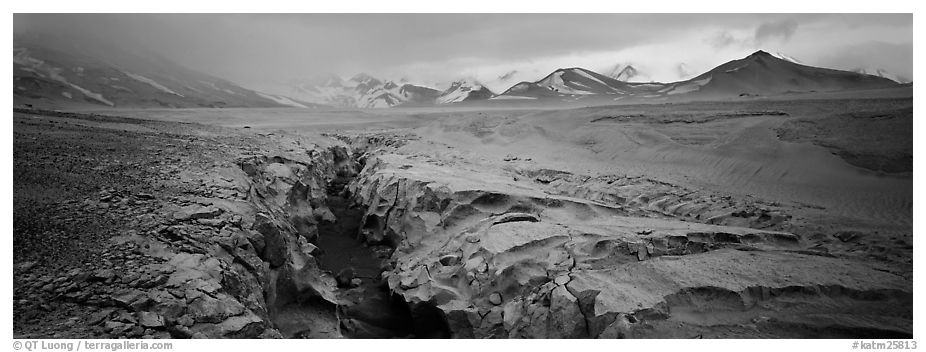 Stormy landscape with ash-covered valley and mountains. Katmai National Park (black and white)