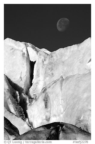 Seracs of Exit Glacier and moon. Kenai Fjords National Park (black and white)