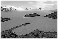 Melting neve in early summer and Harding ice field. Kenai Fjords National Park, Alaska, USA. (black and white)