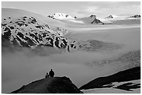 Two people hiking down Harding Ice Field trail. Kenai Fjords National Park, Alaska, USA. (black and white)