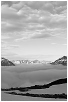 Sea of clouds and craggy peaks. Kenai Fjords National Park, Alaska, USA. (black and white)