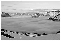 Peaks emerging from clouds at sunset. Kenai Fjords National Park, Alaska, USA. (black and white)
