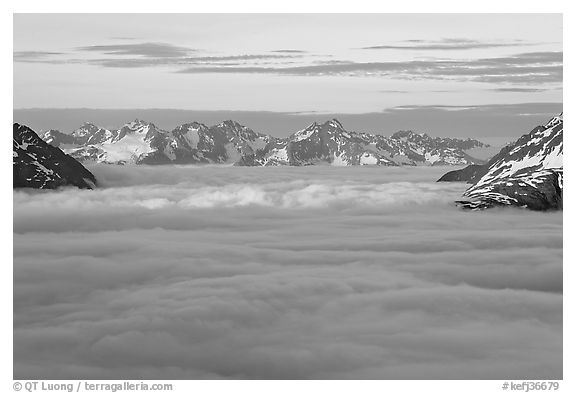Resurrection Mountains emerging from clouds at sunset. Kenai Fjords National Park (black and white)