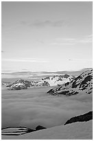 Snowy mountains and see of clouds at sunset. Kenai Fjords National Park, Alaska, USA. (black and white)