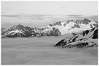 Midnight sunset on peaks above clouds. Kenai Fjords National Park, Alaska, USA. (black and white)