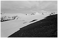 Rocky slope and snow-covered Harding Icefield at dusk. Kenai Fjords National Park, Alaska, USA. (black and white)