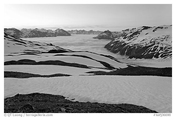 Bands freshly uncovered by snow, and low clouds, sunrise. Kenai Fjords National Park (black and white)