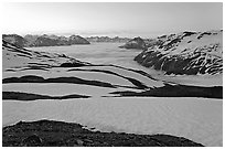Bands freshly uncovered by snow, and low clouds, sunrise. Kenai Fjords National Park, Alaska, USA. (black and white)
