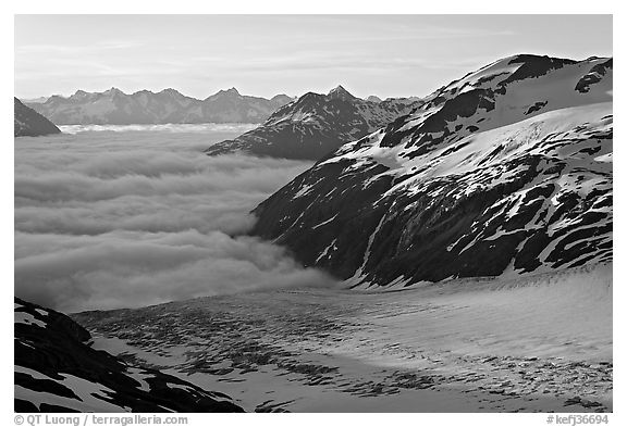 Craggy peaks, glacier, and sea of clouds. Kenai Fjords National Park (black and white)