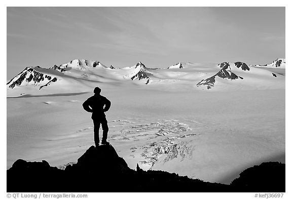 Man standing on overlook above Harding ice field, early morning. Kenai Fjords National Park (black and white)