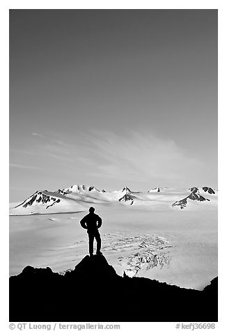 Hiker standing on overlook above Harding icefield. Kenai Fjords National Park (black and white)