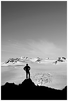 Hiker standing on overlook above Harding icefield. Kenai Fjords National Park, Alaska, USA. (black and white)
