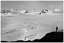 Harding icefield with man standing in the distance. Kenai Fjords National Park, Alaska, USA. (black and white)
