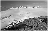 Lichen-covered rocks and Harding ice field. Kenai Fjords National Park, Alaska, USA. (black and white)