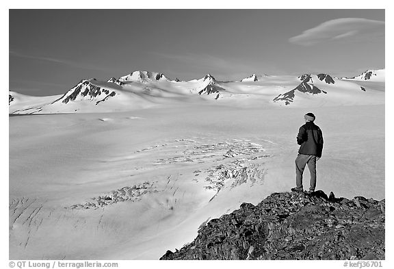 Man looking at the Harding ice field, early morning. Kenai Fjords National Park (black and white)