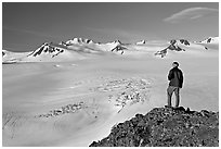 Man looking at the Harding ice field, early morning. Kenai Fjords National Park, Alaska, USA. (black and white)