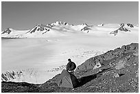 Tent and backpacker above the Harding icefield. Kenai Fjords National Park, Alaska, USA. (black and white)