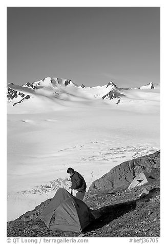 Camper exiting tent above the Harding ice field. Kenai Fjords National Park (black and white)