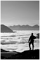 Man above a sea of clouds. Kenai Fjords National Park, Alaska, USA. (black and white)