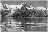 Rippled refections of peaks and glaciers, Northwestern Fjord. Kenai Fjords National Park, Alaska, USA. (black and white)