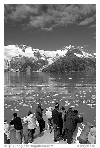 People looking as tour boat slows down for iceberg, Northwestern Fjord. Kenai Fjords National Park (black and white)