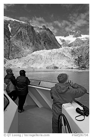 Passengers looking at Northwestern glacier from the deck of tour boat. Kenai Fjords National Park (black and white)