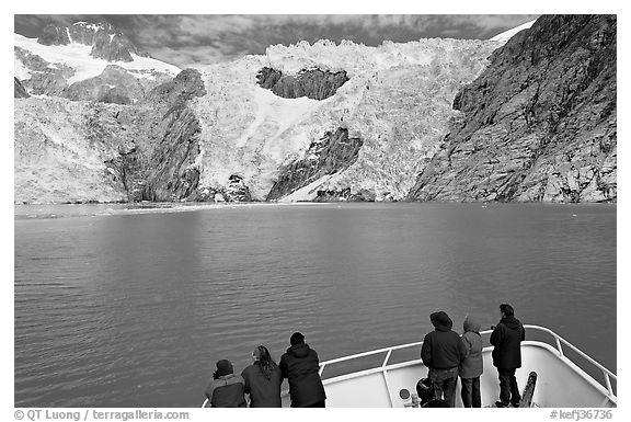 People looking at Northwestern glacier from deck of boat, Northwestern Fjord. Kenai Fjords National Park (black and white)