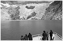 People looking at Northwestern glacier from deck of boat, Northwestern Fjord. Kenai Fjords National Park, Alaska, USA. (black and white)