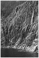 Waterfalls streaming into cove, Northwestern Fjord. Kenai Fjords National Park, Alaska, USA. (black and white)