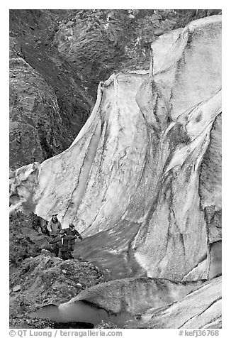 Man and children hiking on moraine at the base of Exit Glacier. Kenai Fjords National Park (black and white)