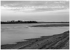 Low sandy shore of Kobuk River at dusk. Kobuk Valley National Park ( black and white)