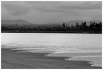 Sand bar shore, bright river and Baird mountains, evening. Kobuk Valley National Park ( black and white)