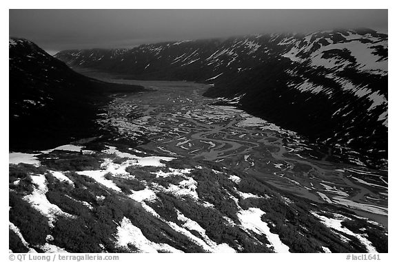 Aerial view of Tikakila River valley under dark clouds. Lake Clark National Park (black and white)