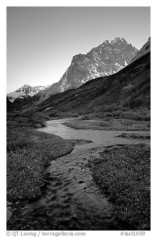 Stream on plain  below the Telaquana Mountains, late afternoon. Lake Clark National Park (black and white)