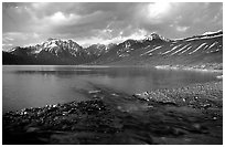 Stream flowing into Turquoise Lake, sunset. Lake Clark National Park ( black and white)