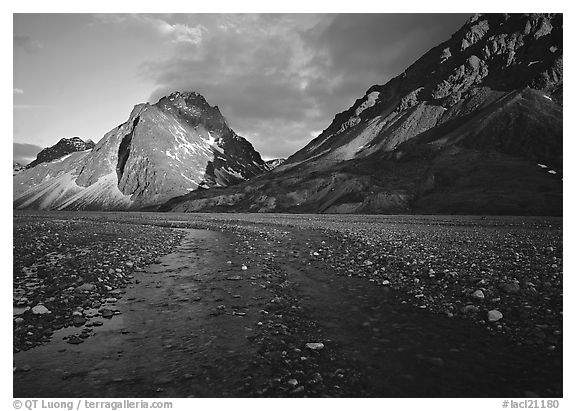 Stream on wide gravel bar and peaks at sunset. Lake Clark National Park (black and white)