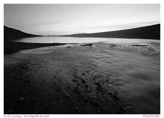 Stream flows into Turquoise Lake, midnight sunset. Lake Clark National Park (black and white)