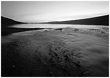 Stream flows into Turquoise Lake, midnight sunset. Lake Clark National Park ( black and white)