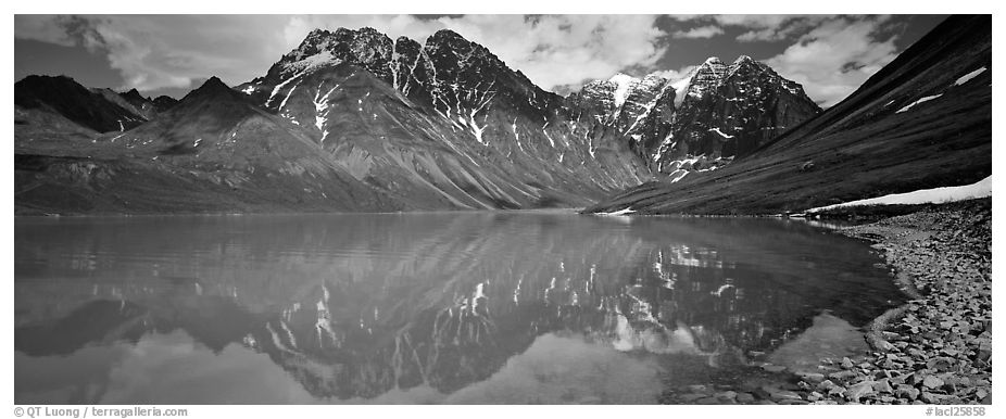 Tall mountains reflected in Turquoise Lake. Lake Clark National Park (black and white)