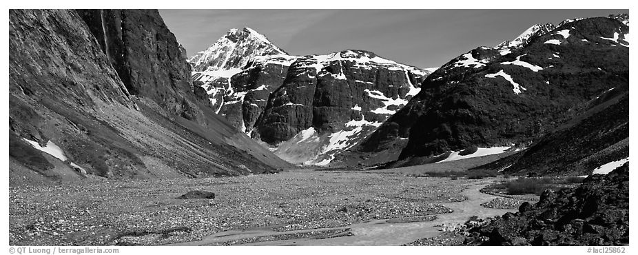 Valley, distant waterfall, and mountains. Lake Clark National Park (black and white)